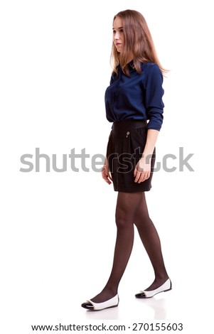 Walking student full body over white background. Studio shooting. Young and successful. Young and rich - stock photo