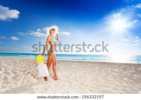 Walking with fins in bag on vacation - stock photo