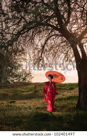 Walking young woman - asian style portrait - stock photo