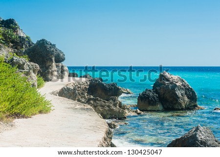 Walkpath close to the shore on tropical island - stock photo