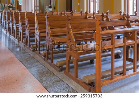 Walkway and Wood Bench of Catholic church, people can pray for god jesus - stock photo