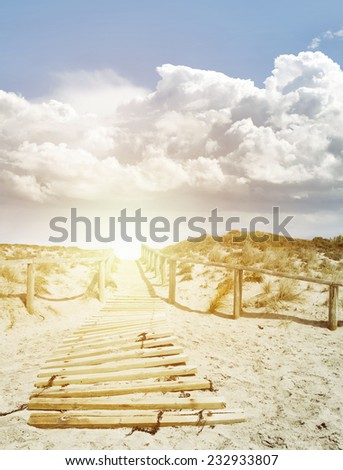 Walkway in sand at beach  - stock photo