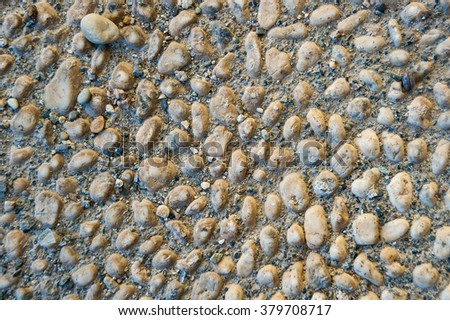 Walkway made of small white stones, typical stone pavement from Liguria - stock photo