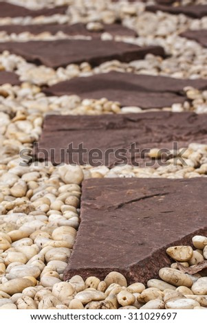 Walkway made â??â??of stone in the garden. - stock photo