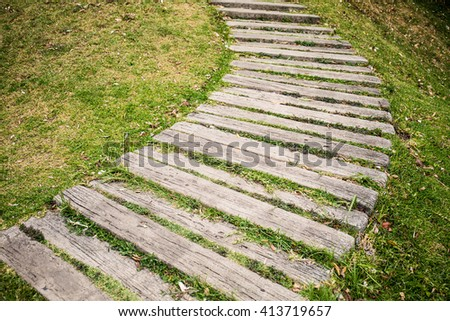 Walkway on green grassy in park. - stock photo