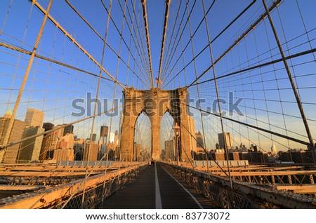 Walkway on the brooklyn bridge in New York City. - stock photo