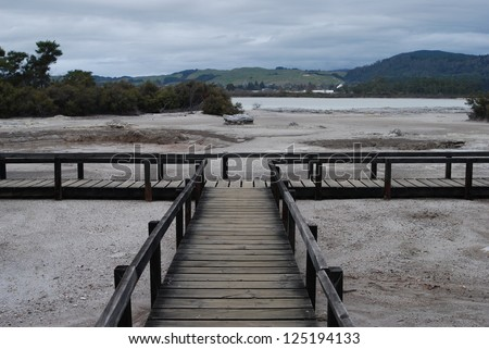 Walkway over a geothermal feature in Rotorua, New Zealand - stock photo