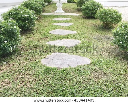 walkway to guardian spirit house or shrine of the household god in white temple , Thailand. - stock photo