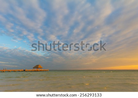 Walkway to sunset on Holbox Island, Mexico, romantic setting for Caribbean vavation - stock photo