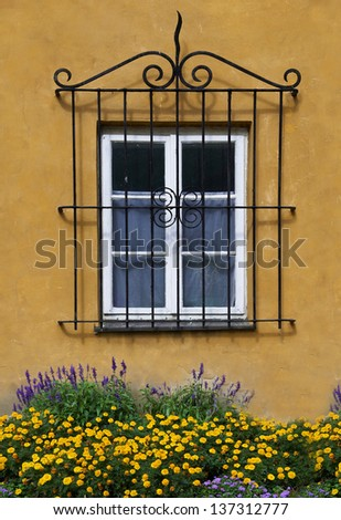 Wall and window with flowers  - stock photo