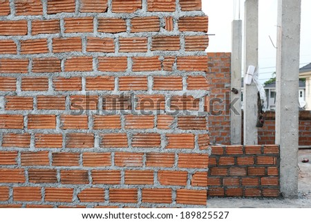 Wall brick of building construction house - stock photo