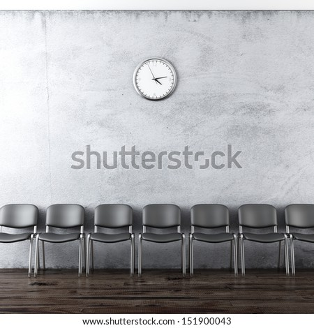 wall clock and black chairs - stock photo