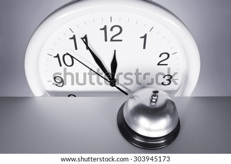 Wall Clock and Call Bell - stock photo