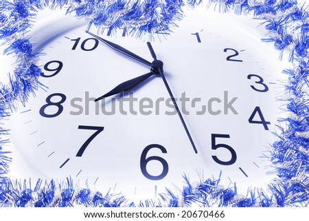 Wall Clock and Tinsel in Blue Tone - stock photo