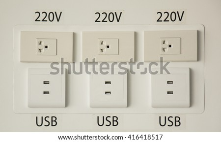 wall electric connection plug and phone charging port with cable wire charging - stock photo
