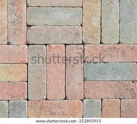 Wall from different colored bricks put together - stock photo