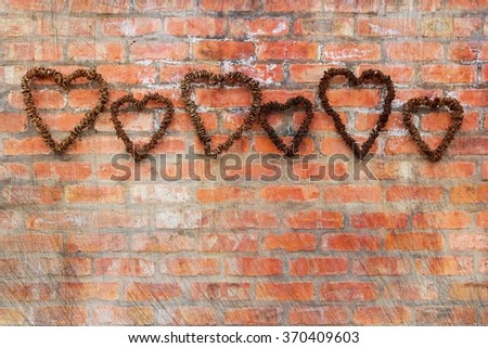 wall hanging art of textured old heart shapes - stock photo