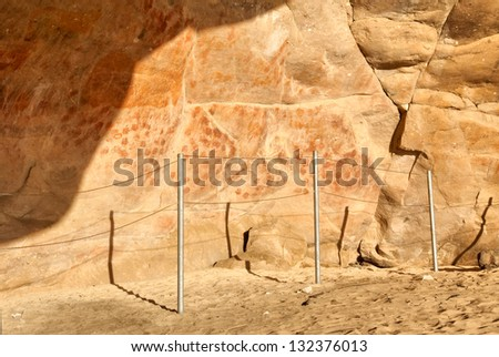 Wall in the Elands Bay cave with rock art. Shot on West Coast, South Africa. - stock photo