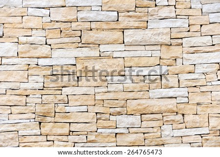 Wall made from new sandstone bricks, stone wall textured background, tiles - stock photo