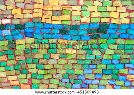 Wall made of colorful stone tiles - stock photo