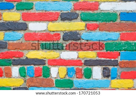 wall made with colorful bricks in Burano - stock photo