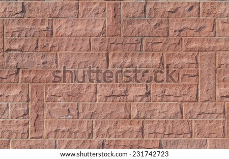 Wall masoned out of red sandstone - stock photo