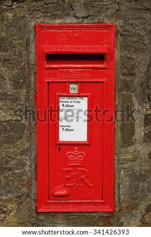 Wall-mounted english postbox - stock photo