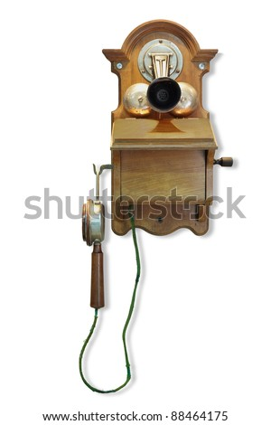 Wall mounted telephone with magneto call. - stock photo