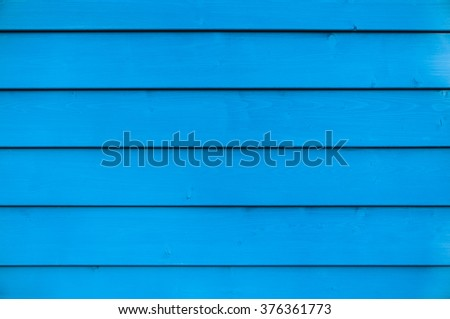 Wall of blue painted wooden slats for background in landscape format - stock photo