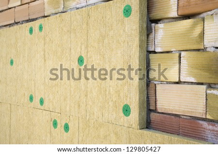 Wall of bricks and insulation wool - stock photo