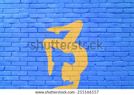 wall of bricks with women contortionist practicing gymnastic yoga posing - stock photo
