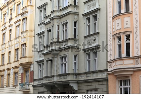 Wall of buildings on a street of Prague - stock photo