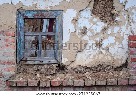 wall of distrucred house with window - stock photo