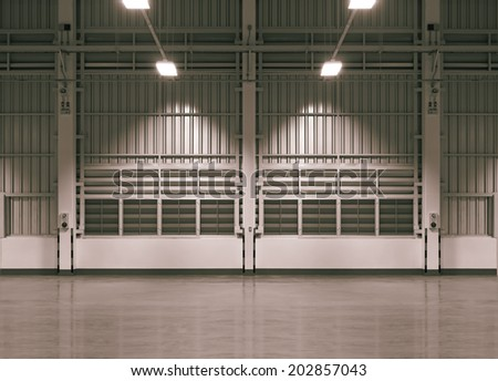 Wall of factory use for background, night time. - stock photo