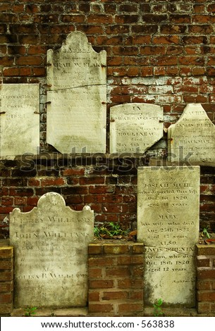Wall of Gravestones - Desecrated during Civil War. - stock photo