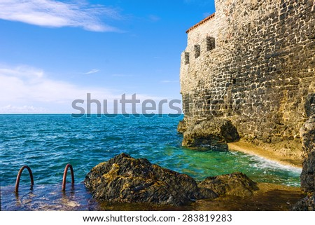 Wall of old town of Budva, Montenegro, Adriatic sea. - stock photo