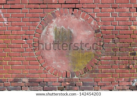Wall of red bricks with a circular alcove in the middle - stock photo