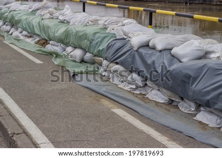 Wall of sandbags for flood defense, sandbag barricaded - stock photo