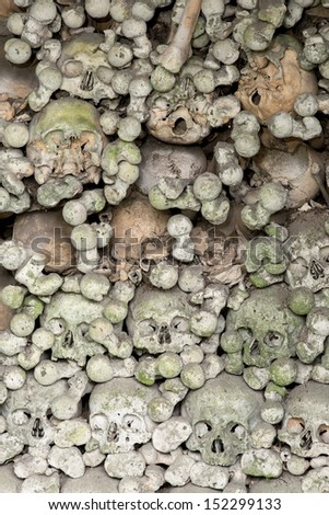 Wall of skulls inside the ossuary of Marville, France, with thousands of ancient skulls of 19th century and older - stock photo