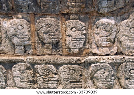 Wall of Skulls (Tzompantli) - Maya Site of chichen itza Yucatan, Mexico - stock photo