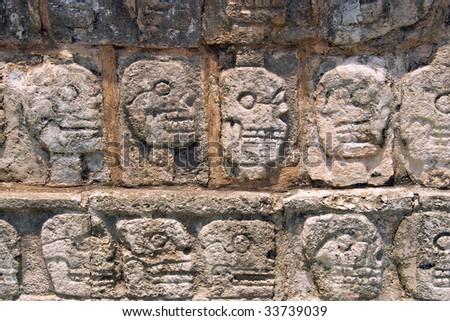 Wall of Skulls (Tzompantli) - Maya Site of chichen itza Yucatan, Mexico - stock photo