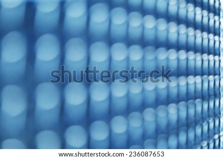 Wall of symmetric row of blurred lights - stock photo