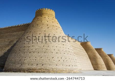 Wall of the Bukhara Fortress, Uzbekistan - stock photo