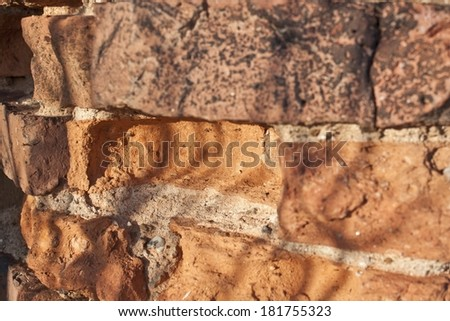 Wall of the old damaged bricks - stock photo