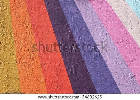 wall painted with a rainbow pattern - stock photo