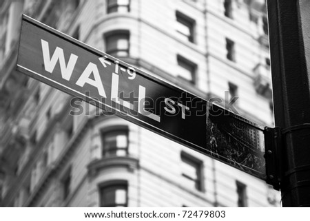 Wall street sign in black and white in New York city close-up view - stock photo