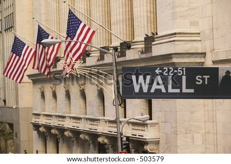 Wall Street sign in front of the New York Stock Exchange - stock photo