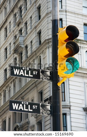 Wall Street signs and traffic lights - New York City, USA - stock photo