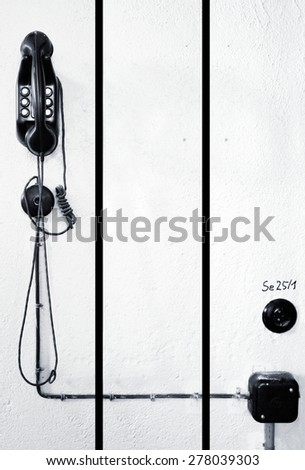 Wall telephone as an split image and black and white transfer. - stock photo