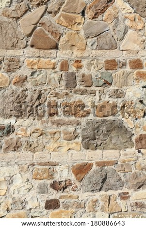 wall-to-face with exposed rocks and stones - stock photo